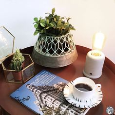 Good morning! We love starting the day watering our office plants with a gentle spritz, and taking a moment to plan the day with a fresh cup of coffee. What's your morning routine?  ClusterHOME's Ascott Table styled with the Outpost lamp, Honeycomb Trinket Box and Highlands tea cup.