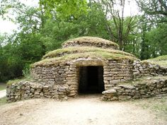 Bougon tumulus and dolmen F0.  This is stated to be the oldest known and dated man made building in all the Atlantic facing lands.  Inside the entrance is a round room, roofed not with a large sla