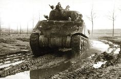 Italian Campaign: a 5th Canadian (Armoured) Division's Sherman tank advance in the mud of the Central Italy. The 5th Canadian (Armoured) Division took part in the Italian Campaign until the end of 1944 seeing notable action on the Hitler Line (in May 1944 Senger Line) and on the Gothic Line in August 1944 (Library and Archives Canada PA-164019).