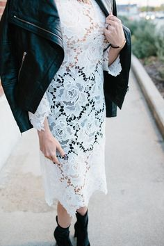 Blogger Lindsey Lutz from Life Lutzurious wearing a white lace dress, leather moto jacket