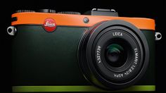 Paul Smith has teamed up with Leica to create the 'Leica Edition Paul Smith camera'. Typical with Paul Smith fashion, the camera features a three tone colour scheme with British racing green with bright orange and fluorescent yellow stripes. Leica Camera, Rangefinder Camera, Paul Smith, Leica Appareil Photo, Nikon D700, Old Cameras, Photography Camera, Fashion Photography, Golden Girls