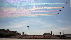 Trailing rainbow colors, Chinese People's Liberation Army Air Force Changhe Z-8 helicopters fly over Tiananmen Square in Beijing at the 2015 Chinese V-J Day Parade.