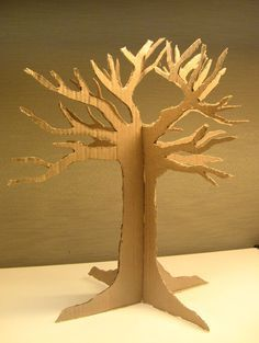 Cardboard tree - trace two, cut slits, combine.  Great idea for an art project at school.