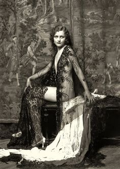 Erté's designs were deliciously exotic and outrageously impractical, which delighted both the working-class girls who worshipped his dresses from afar and the lavishly wealthy women who could afford to make him rich. His gowns were painstakingly hand-made with beads, fur trim, lace, sheer draperies, leather, and glittering embroidery.