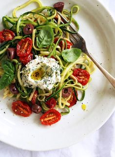Zucchini strands stand in perfectly for traditional pasta in this delicious summer dish.