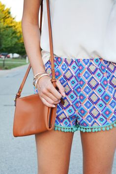 Bright colored shorts paired with a brown bag is a perfect summertime outfit!