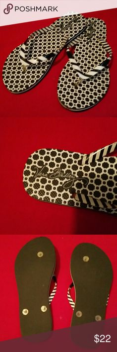 Vera Bradley black and white flip-flops size 7 Too cute black and white flip-flops by Vera Bradley have never been worn, size 7. They have a black and white honeycomb design on the foot and the straps are black and white stripes. Vera Bradley Shoes