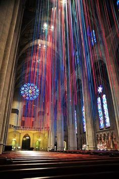 """Installation Art...""""Graced With Light"""" by Anne Patterson, 1,000 satin ribbons artfully hanging from the church arches, and totalling over 20 miles or 32 kilometres in length."""