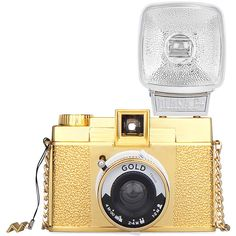 Diana Gold Edition | Galería de fotos 2 de 56 | Vogue ❤ liked on Polyvore featuring camera, accessories, filler, electronics and gold