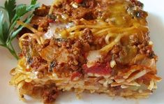 This is one of my all time favorites. It is fantastic to take to potlucks or to a friend who is under the weather. I like eating it the next day as a cold pasta dish. Can't go wrong with this one! Ingredients 16 ozcooked spaghetti noodles 1 cchopped onions 1 cgreen peppers 1 Tbspmargarine 1 can(s)(28 oz) chopped tomatoes 1 tsporegano 1 clovegarlic (or 1/2 teaspoon garlic seasoning) 1 lbcooked ground beef (can substitute chicken or Italian sausage) 2 cmozzarella cheese 1 can(s)cr...