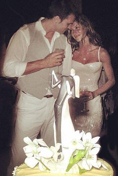 On Super Bowl Sunday, it's important to honor football's most dynamic duo: Tom Brady and Gisele Bündchen. The Patriots' quarterback and supermodel are going strong after eight years of marriage, and pictures from Tom Brady and Gisele Bündchen's… Gisele Bundchen Tom Brady, Tom Brady E Gisele, Tom And Gisele, Celebrity Wedding Photos, Celebrity Wedding Dresses, Celebrity Couples, Celebrity Weddings, Celebrity News, Gisele Bündchen