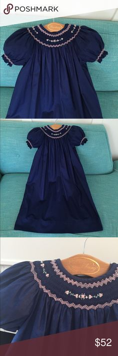 Strasburg dress Gorgeous navy Strasburg dress. Bishops length. Short sleeves, smocked with delicate pink flowers. Comes with full length navy slip to wear beneath. Sz 4 PERFECT condition Strasburg Dresses Formal