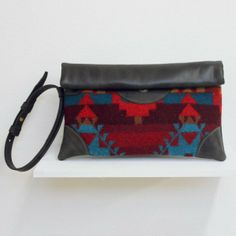Pendelton Wool + African Leather.  Handmade by the wonderful women of Sseko Designs.