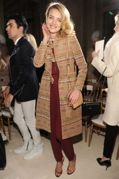 For her front row appearance at the Valentino Spring/Summer 2013 haute couture show, the model opted for a printed tapestry coat over a silk jumpsuit from the house's Fall/Winter 2012-2013 collection.