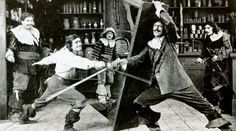 Quiz: How much do you know about The Three Musketeers? (Still from the American film The Three Musketeers (1921) with George Siegmann, Douglas Fairbanks, Eugene Pallette, Charles Belcher, and Léon Bary. Public Domain via Wikimedia Commons.) #Dumas #ThreeMusketeers #lit #film