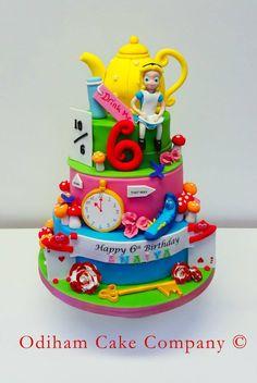 OCC - A 3 tier Alice in wonderland themed cake. #aliceinwonderland #disney #cake #alice #teapot #wonderland