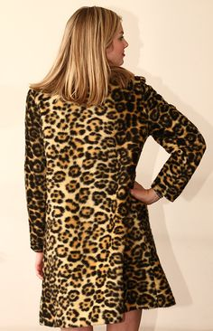 This is made of nice faux leopard fur with nice fun black buttons. It is double breasted for a truly classic look! The chest measures about 42 inches and the coat measure 36 1/2 inches long. Shoulder seam to shoulder seam measures 16 and shoulder seam to end of sleeve measures 24 inches. I think that it would best fit a modern size ten. The jacket is in great condition EXCEPT for the lining. I have photographed the damage to the lining on the inside of the jacket, I have priced the coat ...
