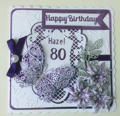Marianne topper die with Tattered Lace butterfly and Spellbinders flowers. Sue Wilson flag with Rob Addams sentiment.