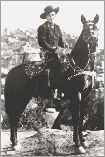 Lash LaRue and his horse Black Diamond.