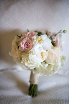 Delicate full bloom roses tied with a brown string
