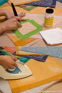 Stenciling with Jacquard Discharge Paste on placemats