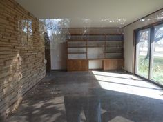 The Master Bedroom of this abandoned mid-century modern house in Oklahoma City, backing onto a mature golf course.