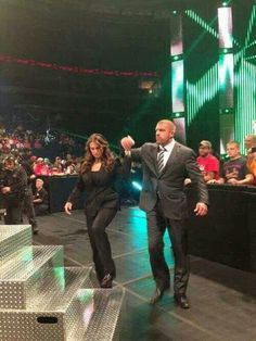 Stephanie McMahon and Triple H enter the ring candid Paul Michael, Stephanie Mcmahon, Triple H, King Of Kings, Wwe Superstars, Celebrity Couples, Mom And Dad, Candid, Mario