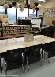 Farmhouse Style Classroom Decor with burlap and black. Neat seats for student chair pockets and galvanized metal utensil carriers for supplies.