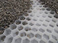 Gravel Stabilisation system - if the sub-layer can be porous concrete, then this would be an attractive and environmentally friendly solution for the parking area in the front garden. With hedges to front and side, underplanted with woodland plants.