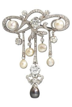 A Belle Epoque natural pearl and diamond corsage ornament, circa 1905. The openwork cartouche composed of meandering old brilliant and single-cut diamond scrolls between two natural pearls, suspending a graduated fringe of natural pearls, old brilliant, single and rose-cut diamonds, terminating in a millegrain-set diamond bow motif, surmounted by an old brilliant-cut diamond and suspending a black natural pearl drop, length 9.3cm, diamond-set chain en-suite. #BelleÉpoque #CorsageOrnament