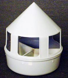 """A heavy duty, plastic feeder that has an insert that creates 3 individual compartments. One for grit, another for minerals, and a third for pickstones or a product of your choice. Remove the divider and have a drinker or feeder. 8"""" wide x 9"""" high."""