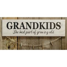 """Grandkids Sign w/Clothespins is made of painted wood and features a jute string with clothespins hanging from the bottom. It measures 6"""" high by 22"""" wide. FREE SHIPPING! WE SHIP IN 3-5 BUSINESS DAYS"""