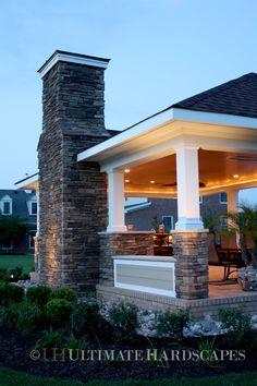 Outdoor cabana #stone fireplace www.ultimatehardscapes.com    https://www.facebook.com/UltimateHardscapes