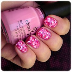 Dotted manicure. Dotting tool, white and lots of different pink and fuchsia polishes, and patience.