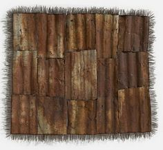 Lorraine Connelly-Northey Look at patchwork with fresh eyes.  Quilts made from corrugated iron ....  or rusted drain pipes and fencing wire