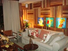 The wood wall pattern gives such a cozy feeling to this living room.