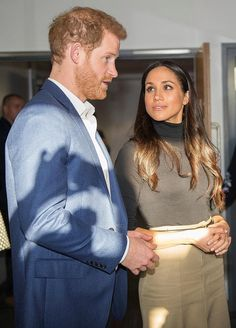 The look of love: Meghan gazes adoringly at her future husband