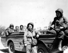 "3 Army Nurse Corps nurses pose with this Ford ""Seep"" (Sea Jeep) From left to right: Lt V Bartholomew, MM2/C L Artzie (the driver, US Navy), Lt G Cox (ANC), Lt H G Blything (ANC) and Lt C Ludkins (ANC)."