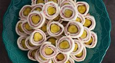Classic recipe for pickle ham and cheese rollups. Delicious appetizers perfect for graduations, bridal or baby showers, barbecues and more.