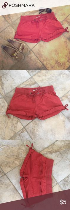 "EEUC Maurice's cotton shorts EEUC Maurice's cotton shorts. Worn once. Like new. Size small. Burnt orange/red color. No wear whatsoever. Adjustable waist & leg with bow tie finish. Waist 15"". Inseam 2 1/2"". Maurices Shorts"