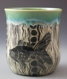 Handmade stoneware cup with etched fish, woodcut design