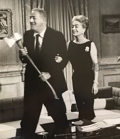 Director William Castle and Joan Crawford publicity stunt for Strait-Jacket, 1964.