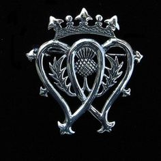 Celtic:  Scottish Luckenbooth - a gift given to the bride to pin on the blanket of the firstborn, for good luck.