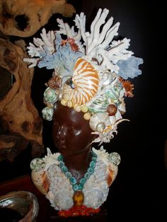 Sculptures | Savannah Shell Art... they do some fantastic stuff, including very heavy, very shell and coral encrusted frames.