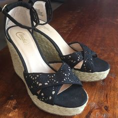 Candie's Wedges Never worn! Black canvas fabric, embroidery, and cream colored braided jute. Heel 4 1/2 in. Cute stuff!! Candie's Shoes Wedges
