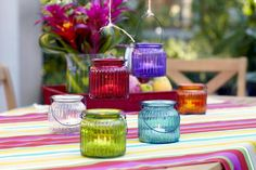 Google Image Result for http://www.recycledbride.com/uploads/listing/30/30877/hanging_glass_jars_candle_holder_ribbed_aqua_blue_orange_green_yellow_hot_pink_wedding_decorations_51492_view0.jpg