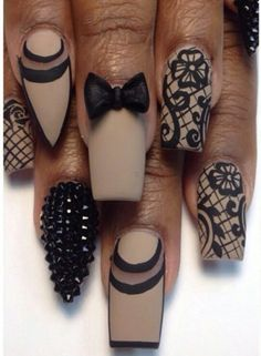 I love that black rhinestoned nail. That on the ring finger nail while every other nail is just plain nude would look so nice