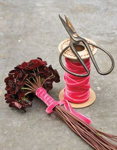 Treat your hostess to a fragrant nosegay. Tie ribbon around long-stemmed flowers, such as chocolate-scented cosmos. First strip the flowers of their leaves. Then starting from the top, wrap the ribbon around the stems for about five inches. Leave the remaining stems bare.
