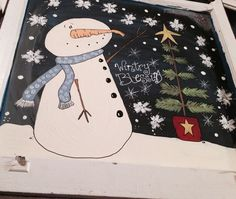 Snowman painted on an old window
