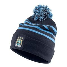 The Nike Man City beanie hat adds warmth to the cold. Show your Manchester  City · City PrideSoccer ... 07ab2d3c50b